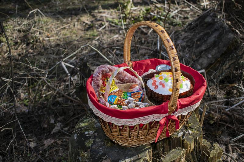 Easter basket with food. And Easter cake royalty free stock photo
