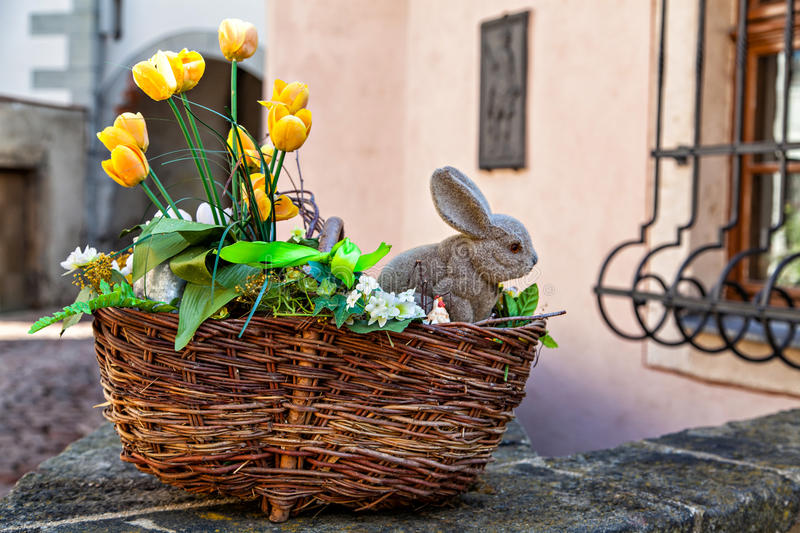Easter basket with yellow flowers and baby bunny royalty free stock images
