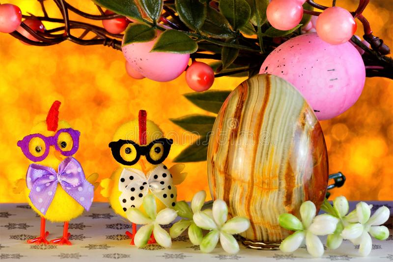 Easter is a big and bright holiday, a cheerful chicken hatched from an egg...Easter is a great and bright holiday. The traditional. Easter gift is a painted egg royalty free stock photography