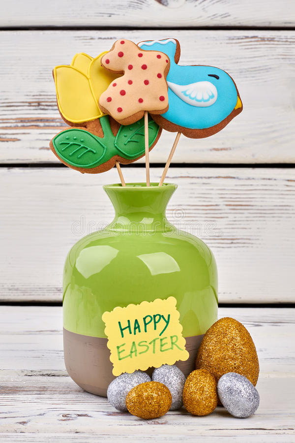Easter biscuits and crafts. Sparkly eggs and greeting card stock photo