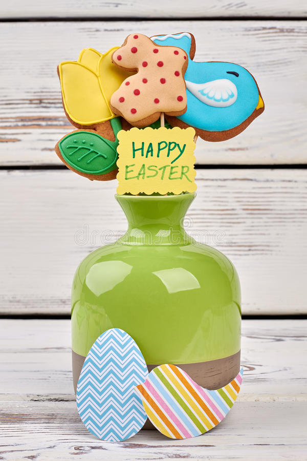 Easter biscuits and paper crafts. Vase with greeting card royalty free stock photos