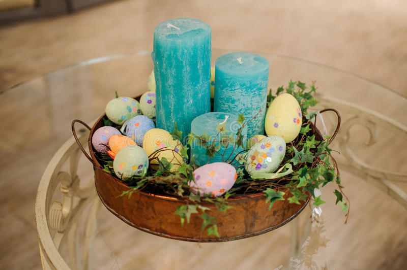 Easter blue candle eggs composition royalty free stock photography
