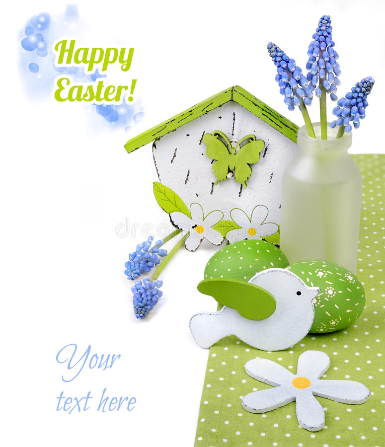 Easter border with blue hyacinth and green decorations on white royalty free stock photography