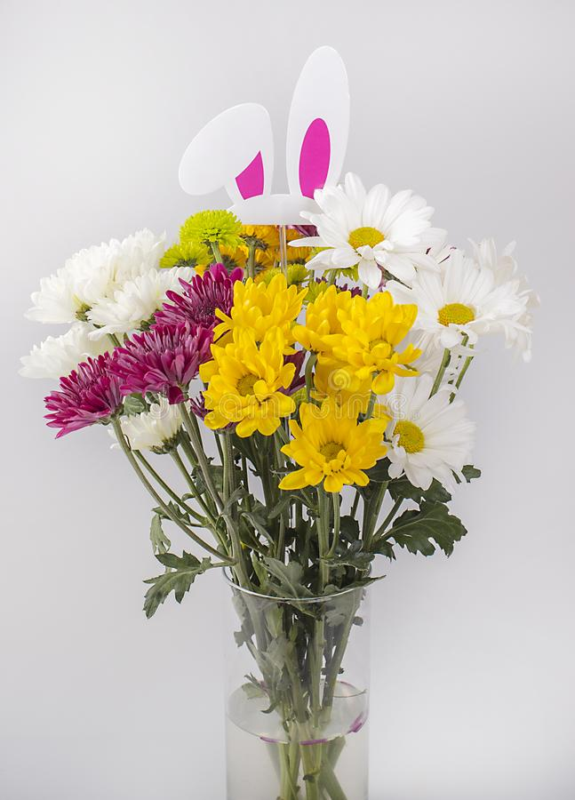 Easter Spring Flowers With Bunny Ears stock images