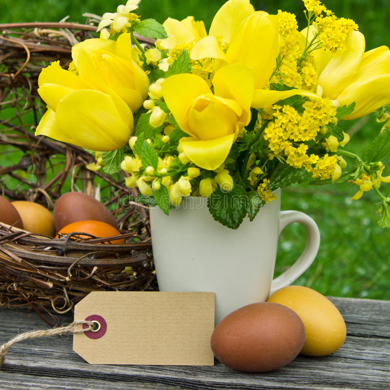 Easter. Bouquet with spring flowers easter eggs and label stock image