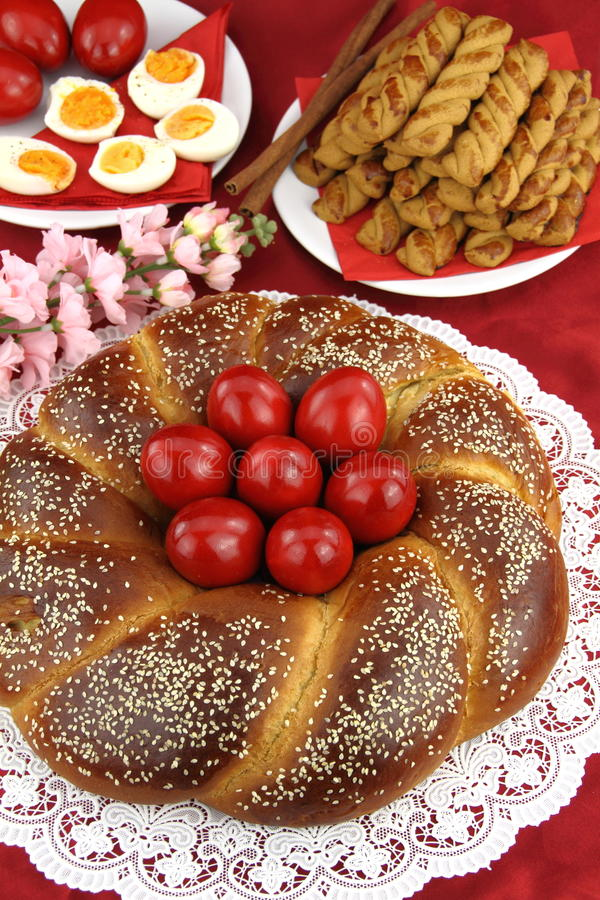 Easter bread. A traditional sweet brioche bread, called tsoureki, decorated with red eggs (Greek recipe stock photos