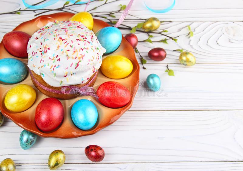 Easter bread and colorful eggs on a wooden, white background. royalty free stock photos