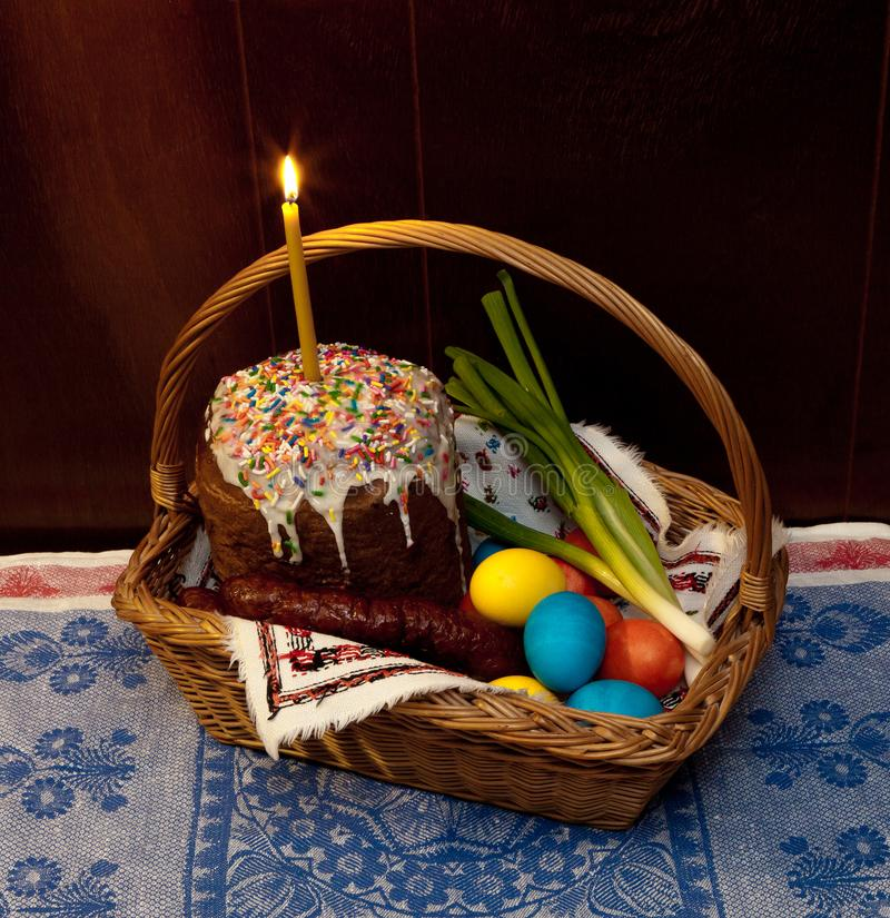 Easter bread, eggs, green onions and sausage in basket. Easter bread, sausage and Easter eggs in basket is traditional set up in Ukraine royalty free stock photos