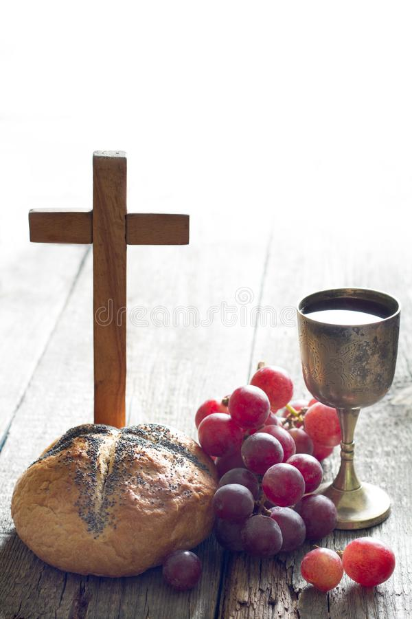 Easter bread wine and cross on vintage old wooden background royalty free stock photo