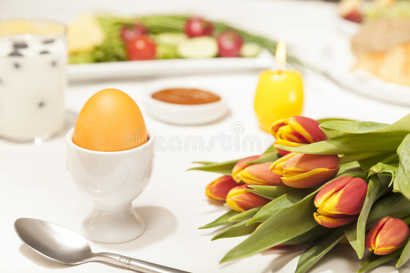 Easter breakfast. With egg and tulips stock photo