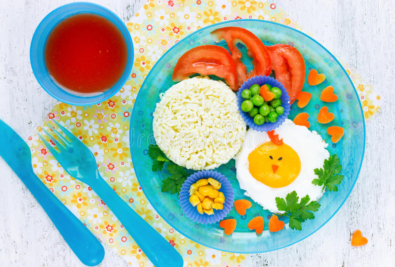 Easter breakfast for kids egg colorful vegetables. Cute idea for healthy child food top view stock photos