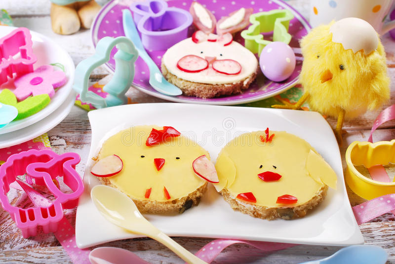 Easter breakfast for kids with funny sandwiches royalty free stock photography