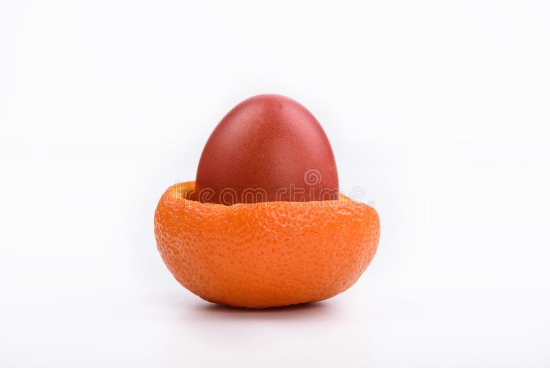 Easter bright egg in mandarin crust royalty free stock photo