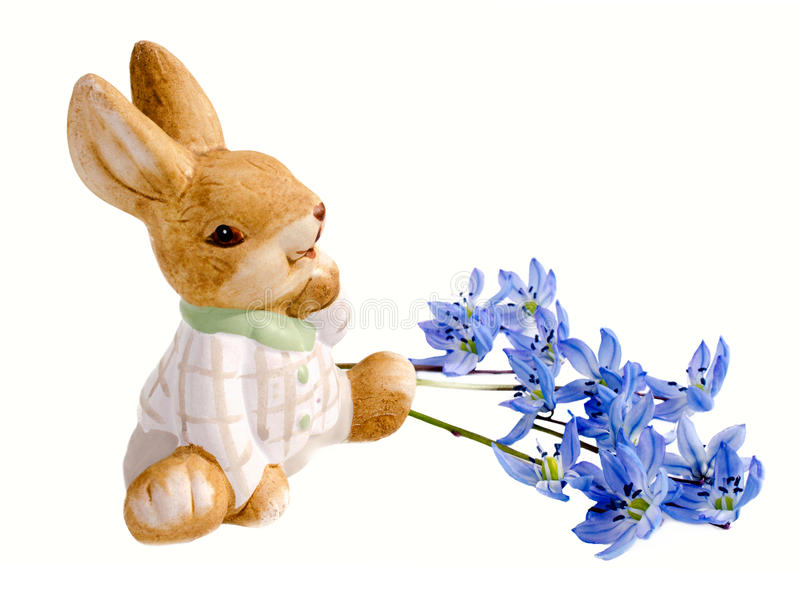 Easter bunnie and blue Scilla. Isolated on white background royalty free stock photo