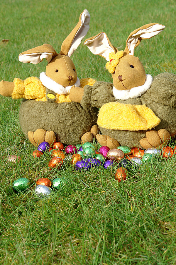 Easter bunnies and chocolate eggs royalty free stock images