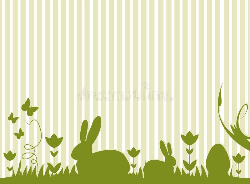Easter bunnies and eggs on a meadow stock images