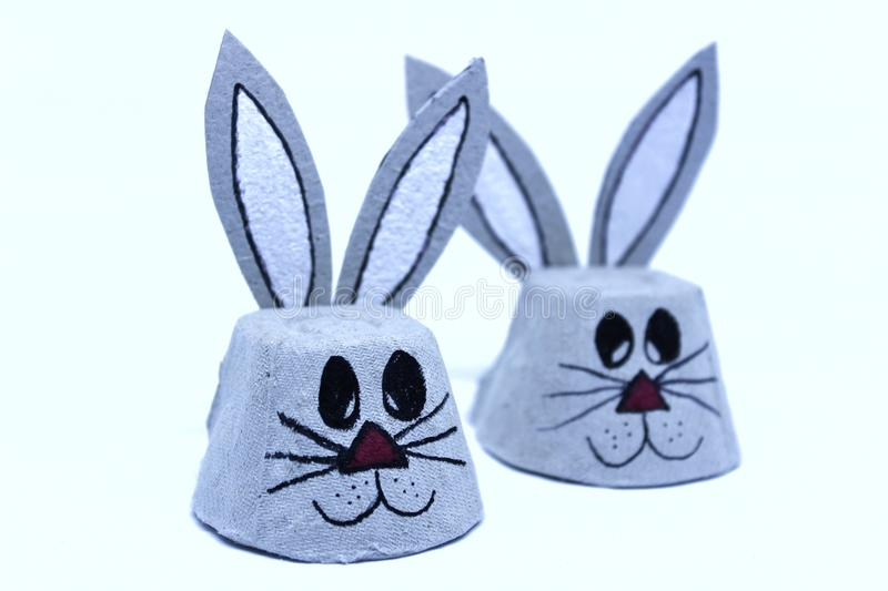 Easter bunnies made of cardboard egg cups stock images
