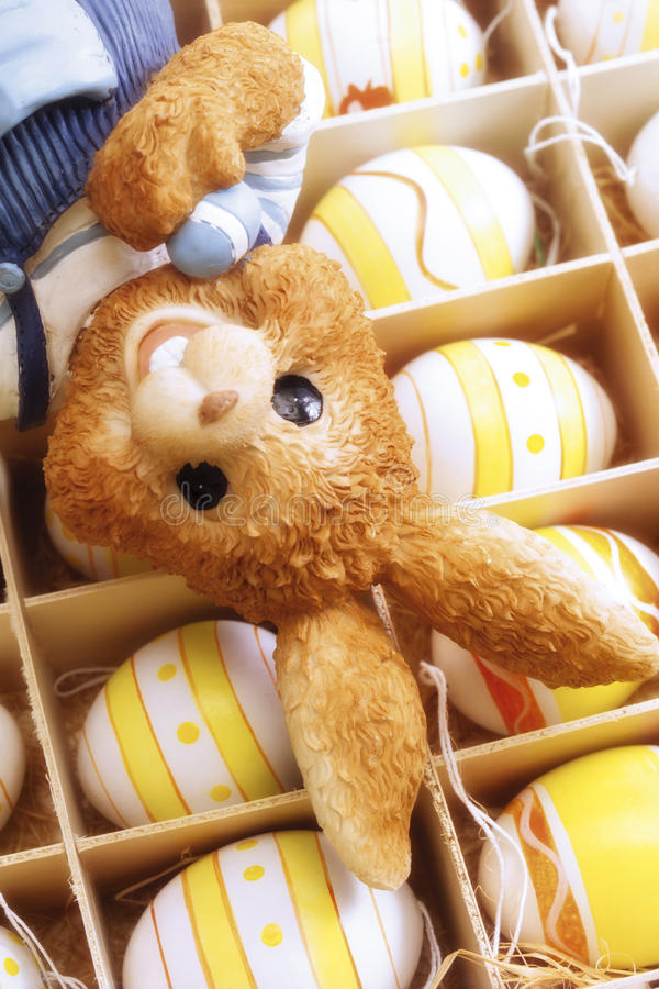 Easter bunny on box with eggs royalty free stock image