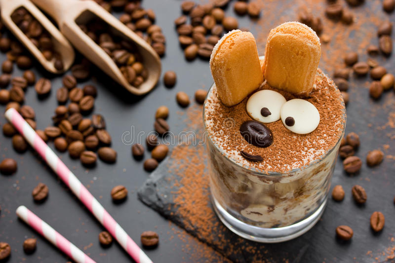 Easter bunny cake tiramisu dessert for children. Funny traditional Italian dessert serving, creative idea holiday sweet food for kids selective focuse stock photos