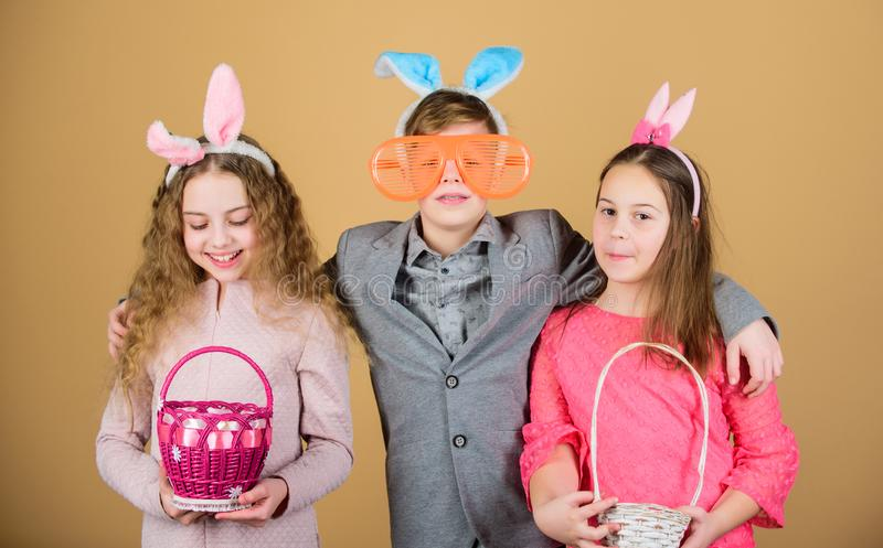 Easter bunny. Children in rabbit bunny ears. Spring holiday party. Egg hunt. Family and sisterhood. Little girls and boy royalty free stock photography