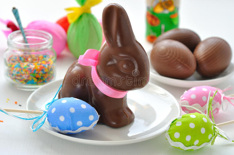 Easter Bunny and chocolate eggs royalty free stock photos