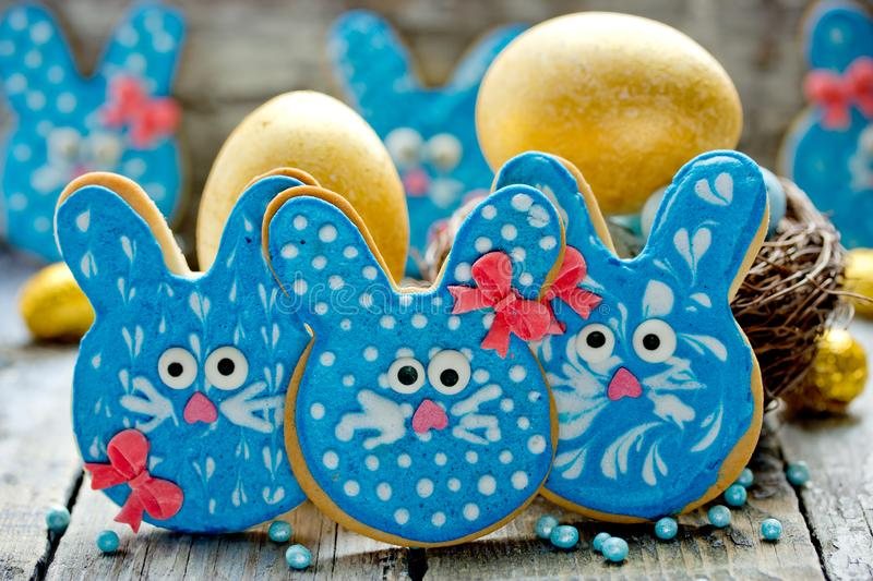 Easter bunny cookies, homemade painted gingerbread biscuits in glaze shaped funny rabbits. For Easter treats royalty free stock photography