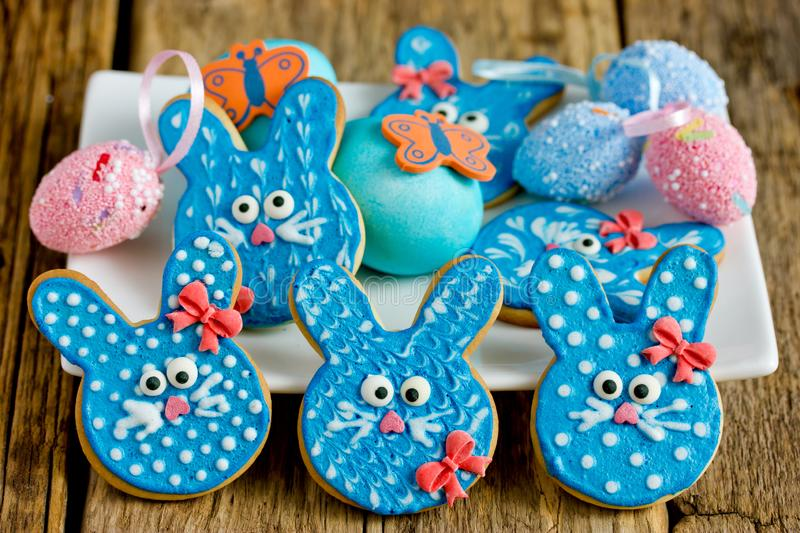 Easter bunny cookies, homemade painted gingerbread biscuits in glaze shaped funny rabbits for Easter. Treats stock photos