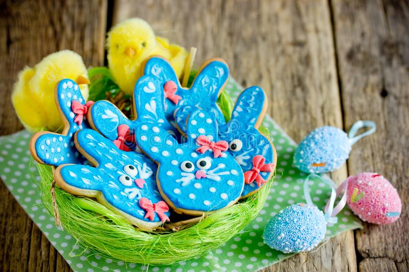 Easter bunny cookies, homemade gingerbread biscuits for Easter treats. Easter bunny cookies, homemade painted gingerbread biscuits in glaze shaped funny rabbits royalty free stock images