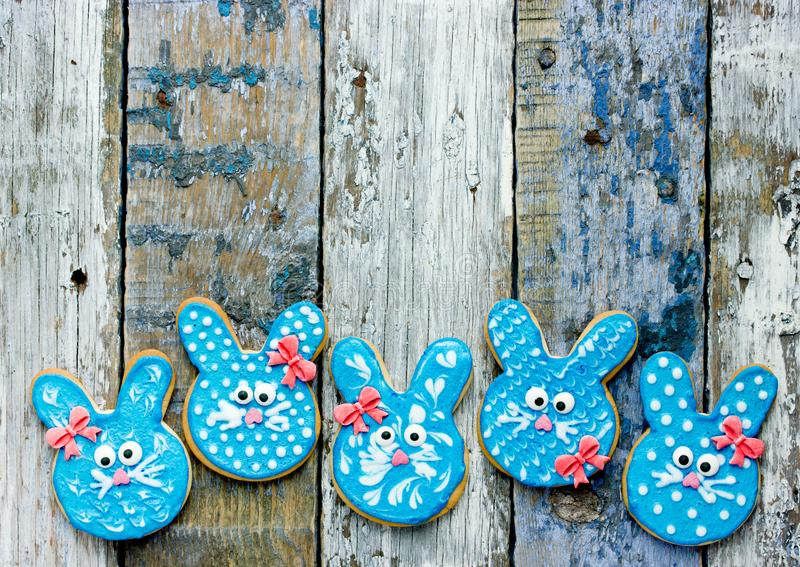 Easter bunny cookies, homemade painted gingerbread biscuits in glaze shaped funny rabbits. For Easter treats stock image