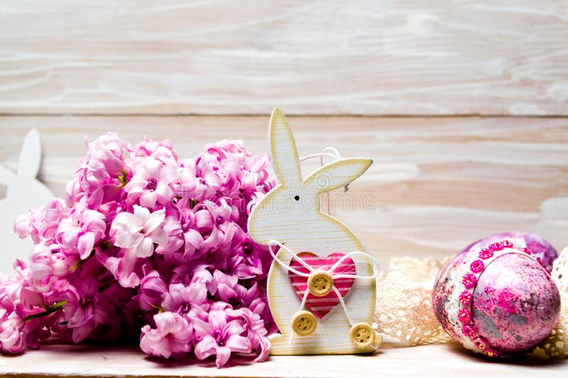 Easter bunny with eggs and fresh hyacinth flowers royalty free stock photos