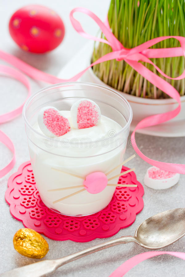 Easter bunny dessert cream in glass , funny idea for Easter treats for kids. Easter recipe stock photo