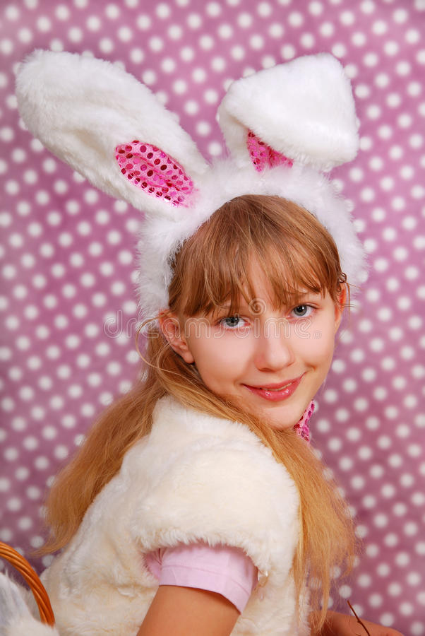 Easter bunny girl with funny ears. On purple background with dots stock image
