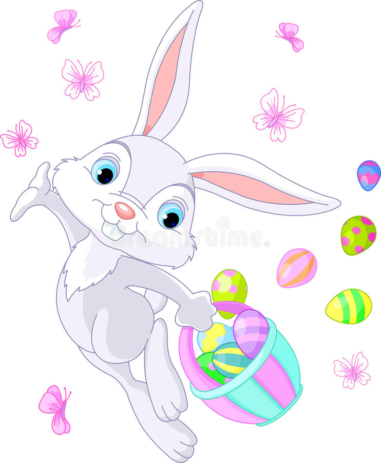 Easter Bunny Hiding Eggs Royalty Free Stock Photography