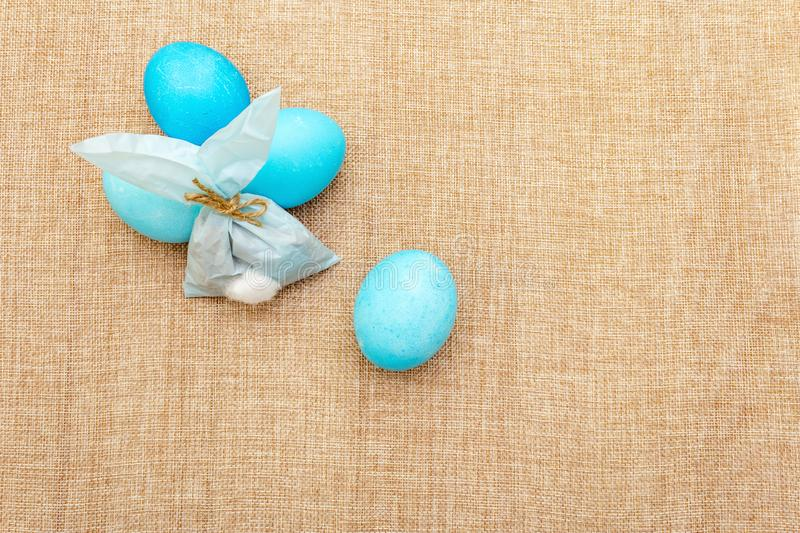 Easter bunny rabbit paper gift egg wrapping idea. Handicraft homemade concept for children kids. On cloth linen background royalty free stock photography