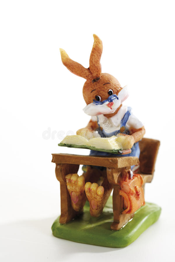 Easter bunny sitting on form royalty free stock images