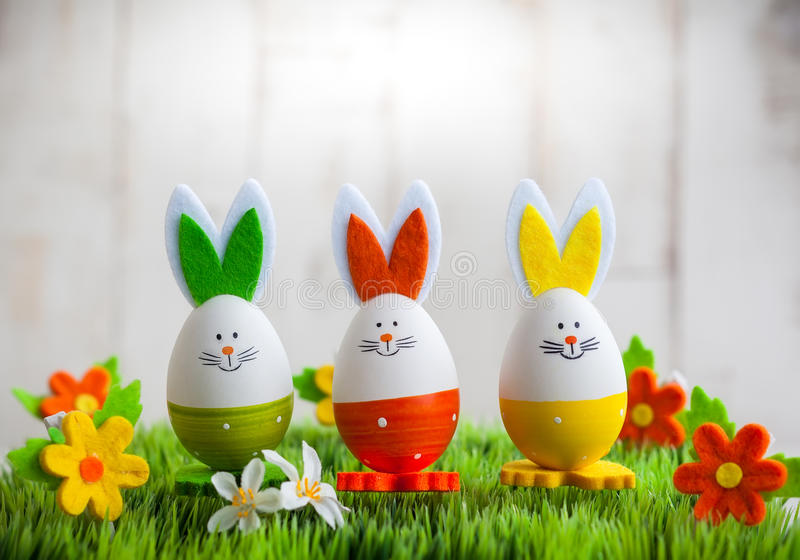 Easter bunny. Three colourful easter bunny on the green grass stock photos