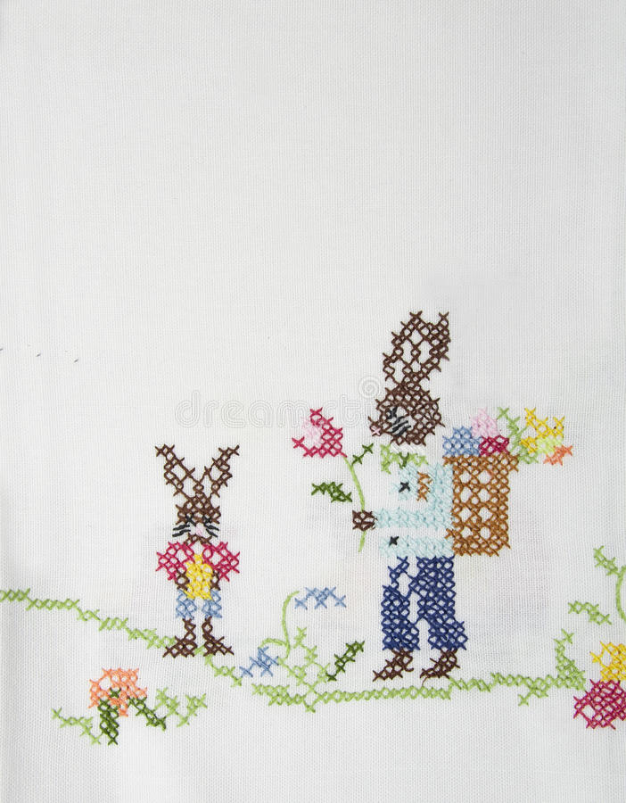 Easter bunny on a white tablecloth. stock images