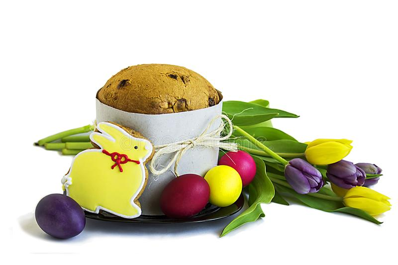Easter cake, bouquet of tulips and easter eggs. On white background royalty free stock images