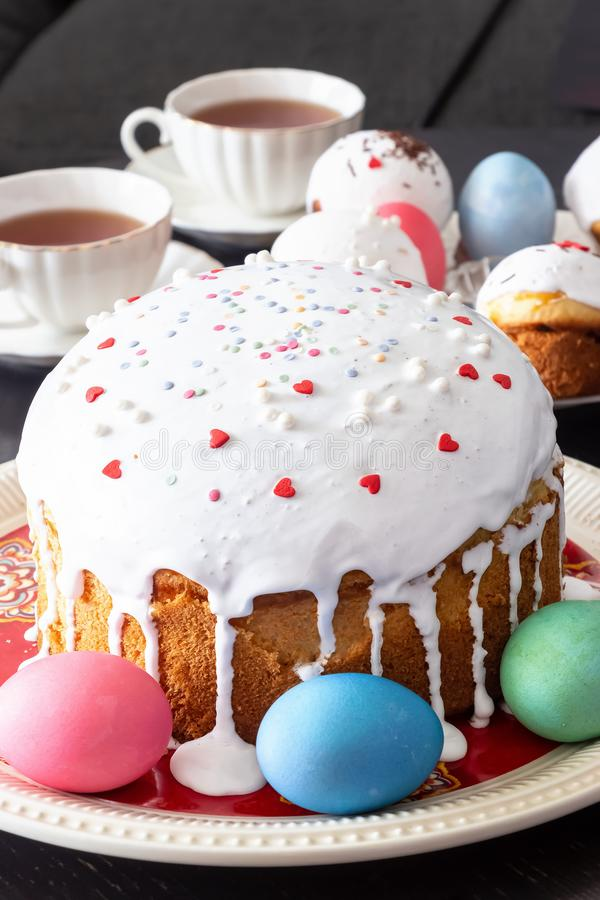Easter cake and colorful eggs close-up. Happy Easter family breakfast concept. Selective focus. Easter cake and colorful eggs close-up. Happy Easter family stock image