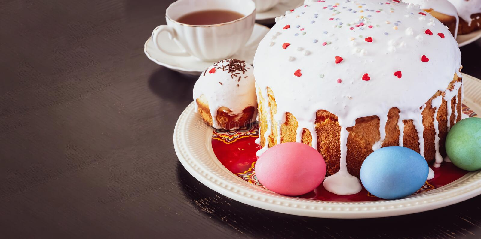Easter cake and colorful eggs close-up. Happy Easter family breakfast concept. Selective focus. Toned photo royalty free stock photography