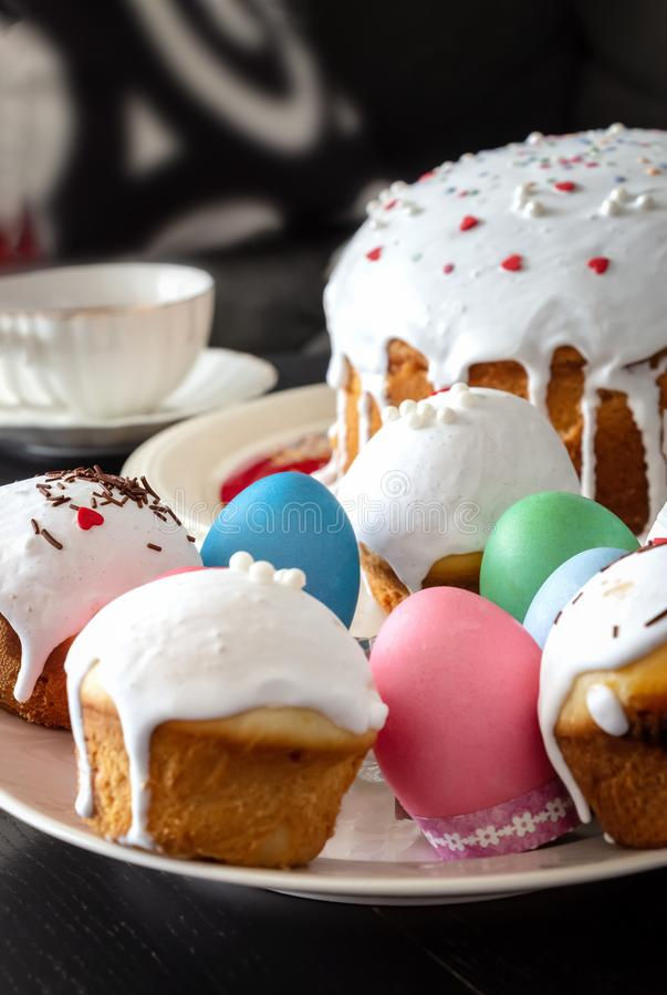 Easter cake and colorful eggs close-up. Happy Easter family breakfast concept. Selective focus. Easter cake and colorful eggs close-up. Happy Easter family royalty free stock images