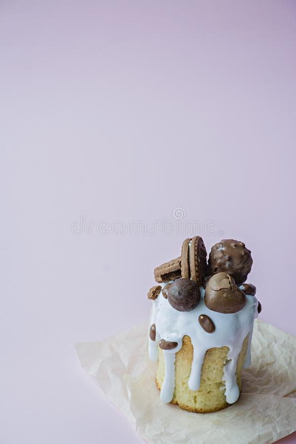 Easter, Easter cake decorated with chocolate and cookies. Traditional Kulich, Easter Bread. Spring holiday in memory of the stock photo