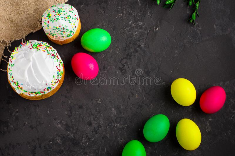 Easter cake and Easter eggs, traditional holiday attributes Happy Easter!. food background. top view. Easter cake and Easter eggs, traditional holiday attributes stock image