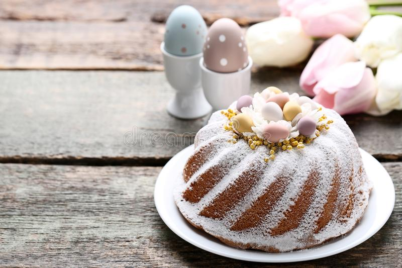 Easter cake with eggs and flowers royalty free stock image