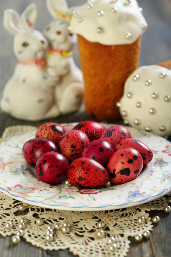 Easter cake, eggs and rabbits. Easter cake, eggs and rabbits on a wooden table royalty free stock image