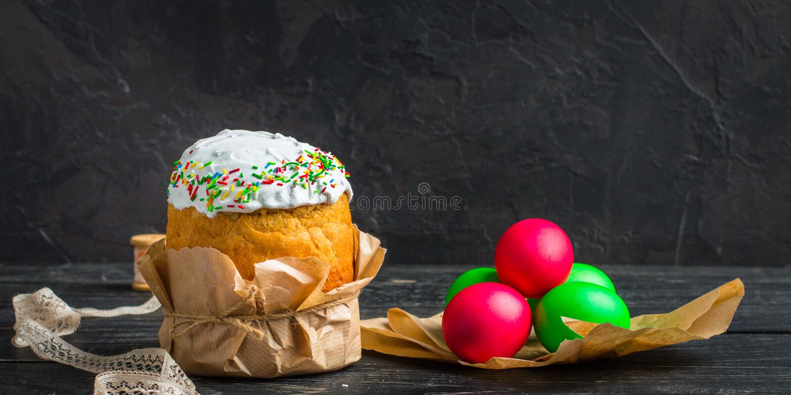 Easter cake and Easter eggs, traditional holiday attributes Happy Easter!. food background. dark background. top stock photography