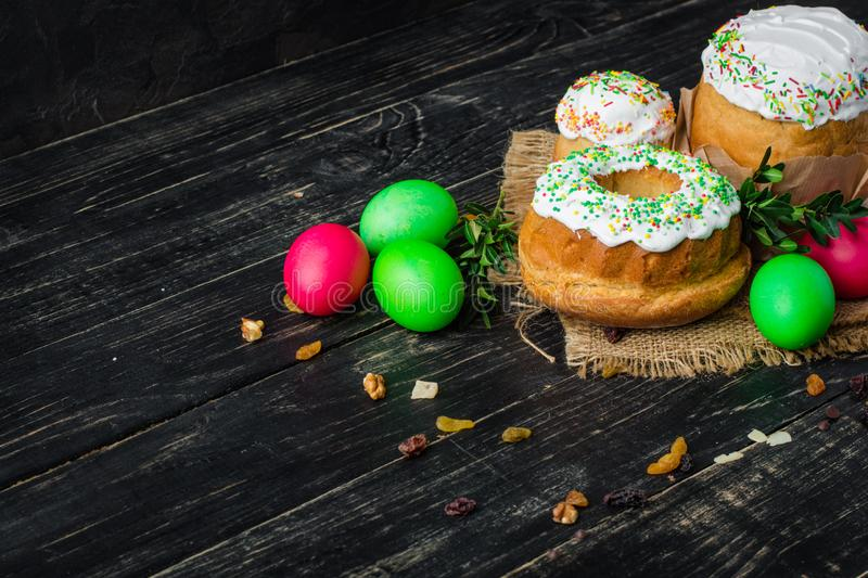 Easter cake and Easter eggs, traditional holiday attributes Happy Easter!. food background. dark background. top stock image