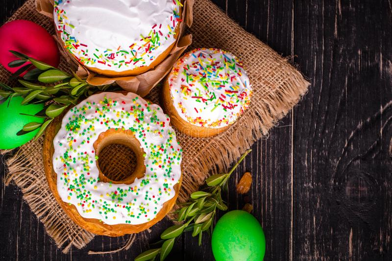 Easter cake and Easter eggs, traditional holiday attributes Happy Easter!. food background. dark background. top stock photos