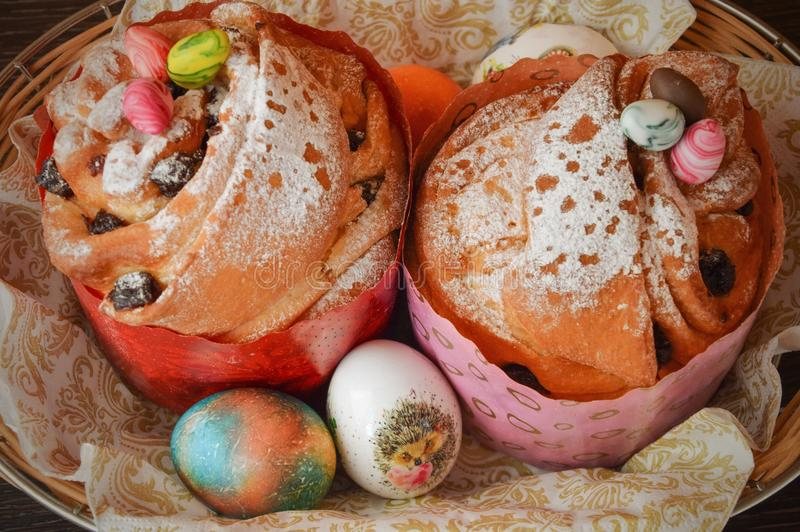 Easter cake and painted chicken eggs. Easter tradition. Appetizing Easter cake and beautiful painted chicken eggs. Festive traditions and treats for the table stock images