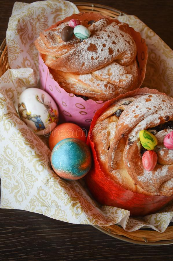 Easter cake and painted chicken eggs. Easter tradition. Appetizing Easter cake and beautiful painted chicken eggs. Festive traditions and treats for the table stock photo